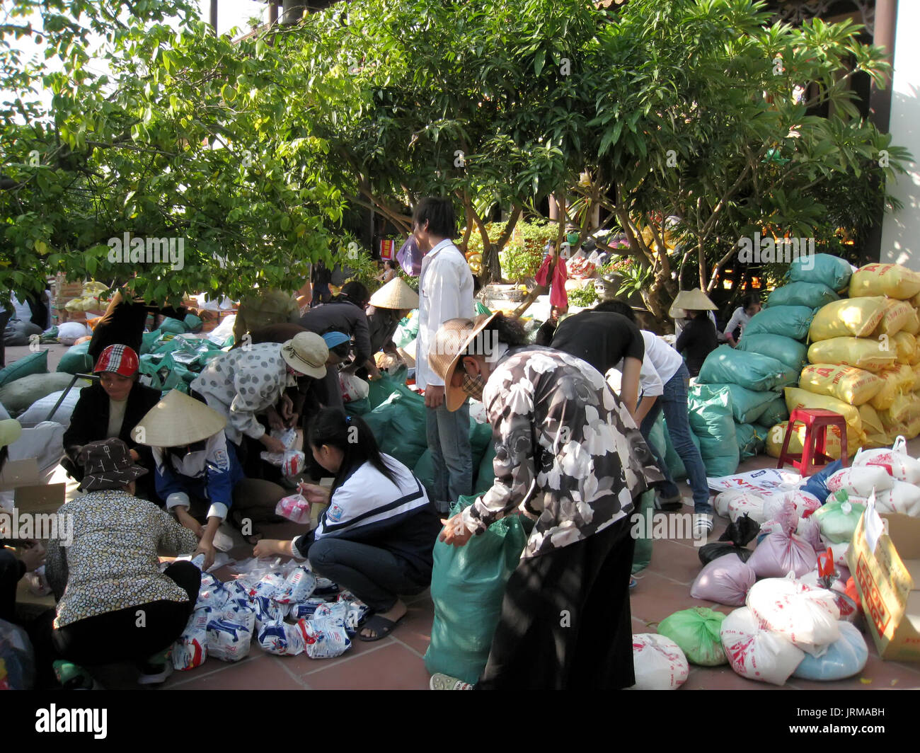 HAI DUONG, VIETNAM, September, 19: monks and disciples contribute food to charity for the poor on September, 19, 2013 in Hai Duong, Vietnam - Stock Image