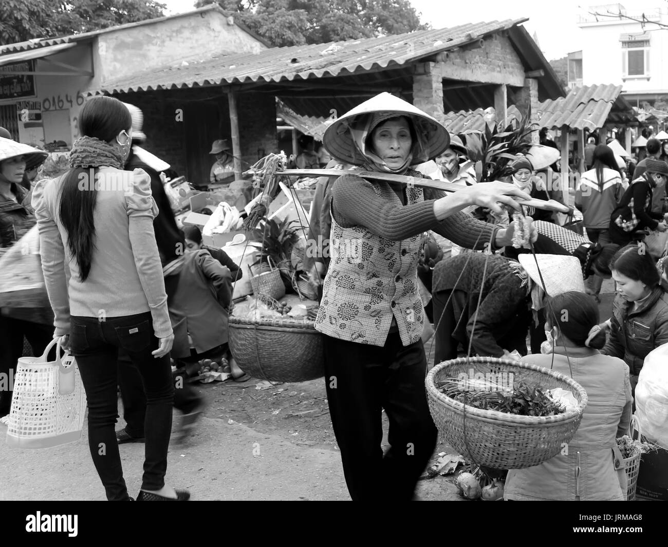 HAI DUONG, VIETNAM, April, 2: Asian woman selling vegetables at the market on April, 2, 2014 in Hai Duong, Vietnam. - Stock Image