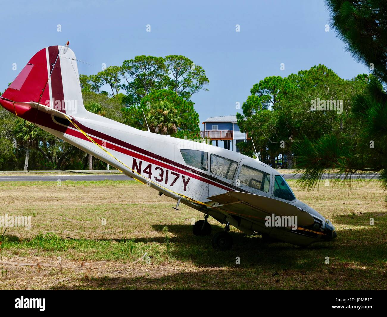 Piper PA 23 160 Apache damaged aircraft, runway overrun on 16 June 2017, no injuries, twin engine small plane, nose down. Cedar Key, Florida, USA. - Stock Image