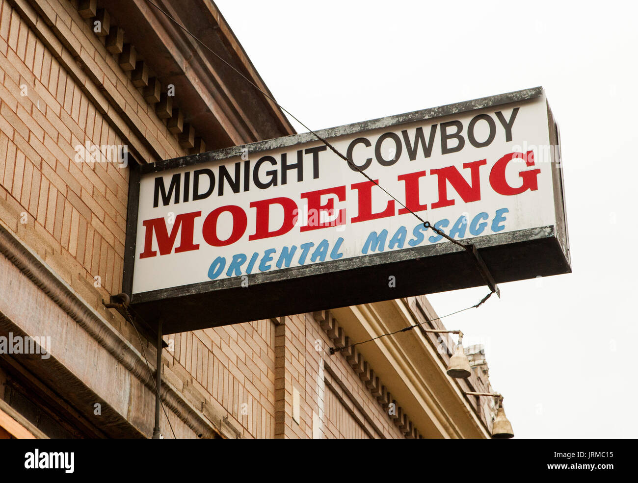 Austin, Texas sign that reads: 'Midnight Cowboy Modeling Oriental Massage,' when the site housed a sketchy massage parlor. - Stock Image