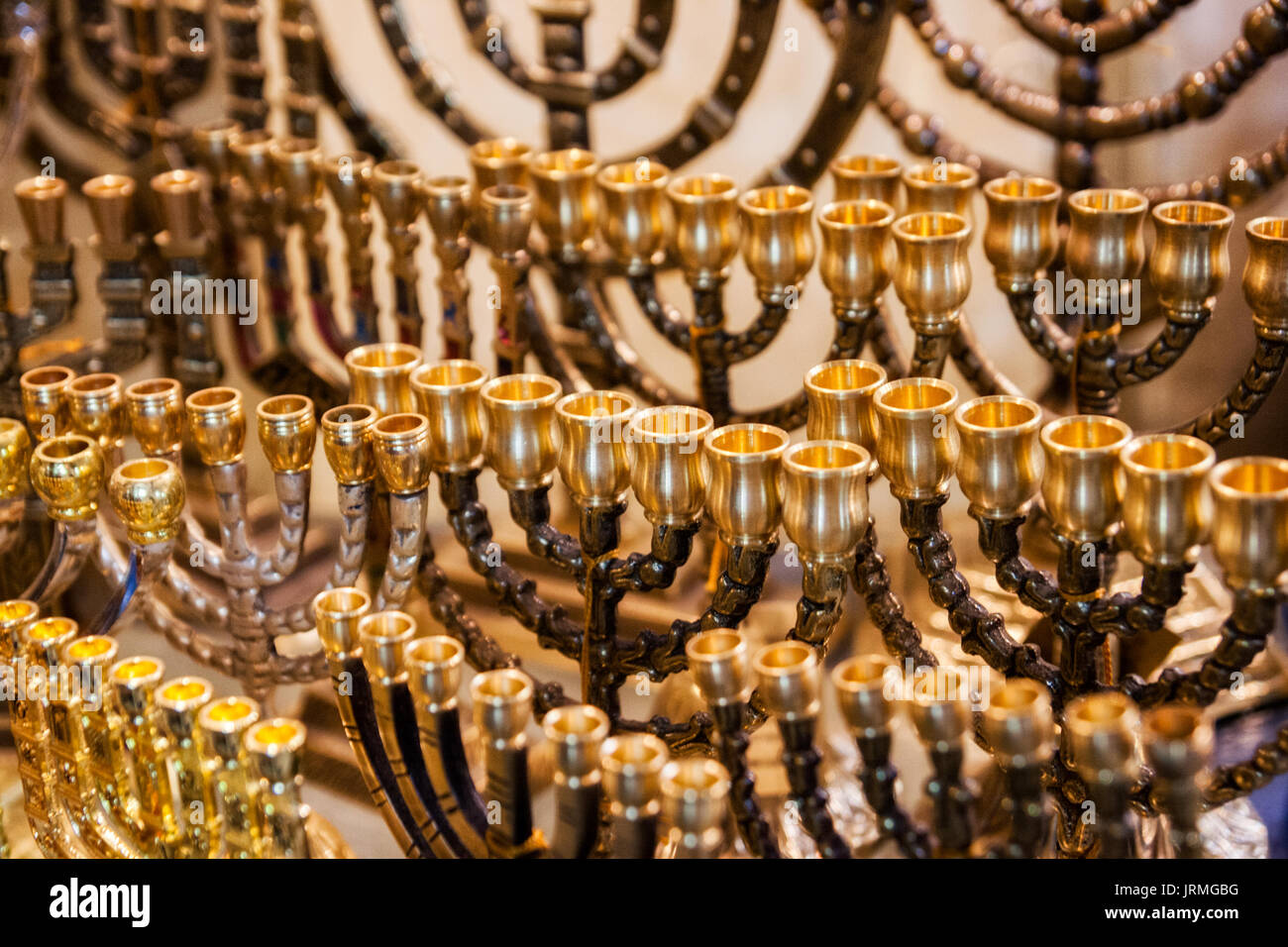 Menorah (traditional candelabra) candles used for the jewish holiday Hanukkah for sale in a tourist shop in Jerusalem, Israel - Stock Image