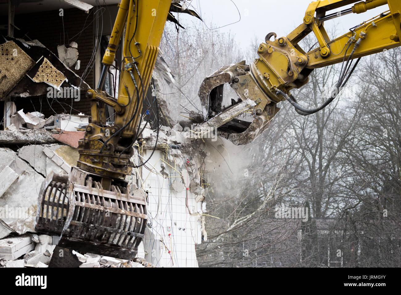 Demolition cranes dismantling a building Stock Photo