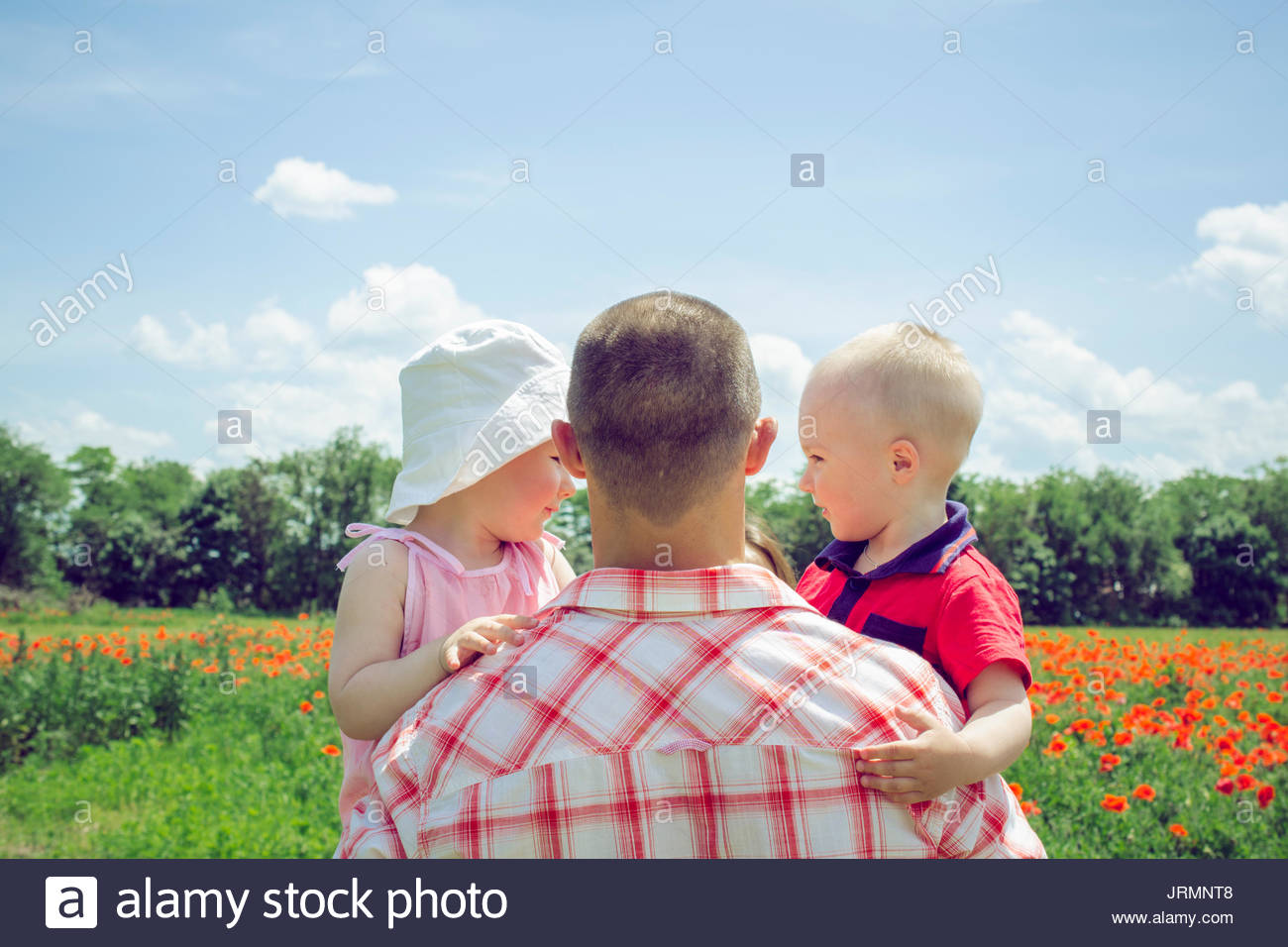 Father holding two children Stock Photo