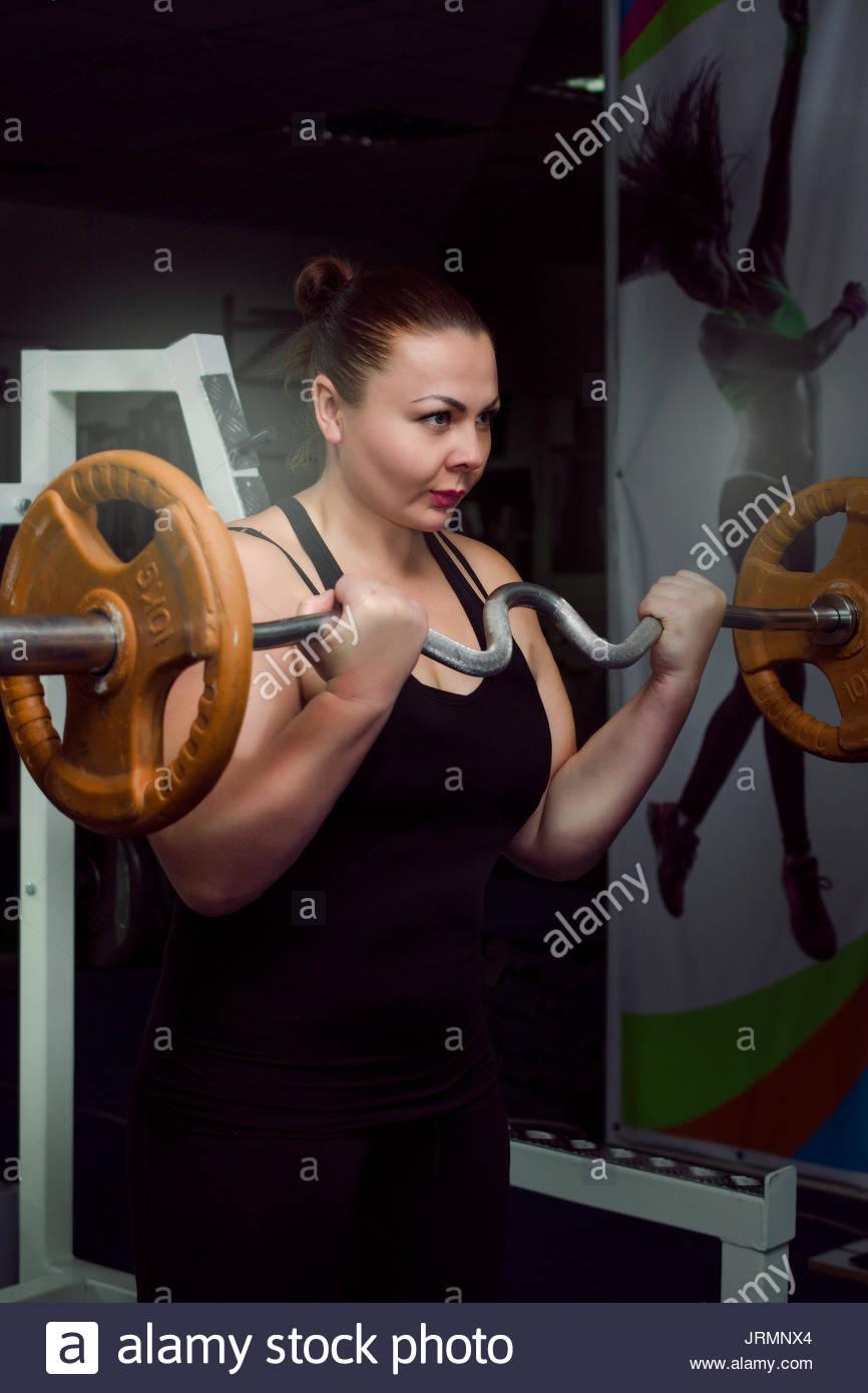 Girl in bodybuilding training Stock Photo
