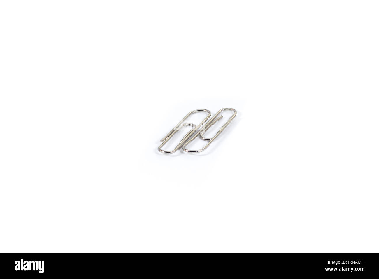 a pile of paper clips on white isolate background - Stock Image