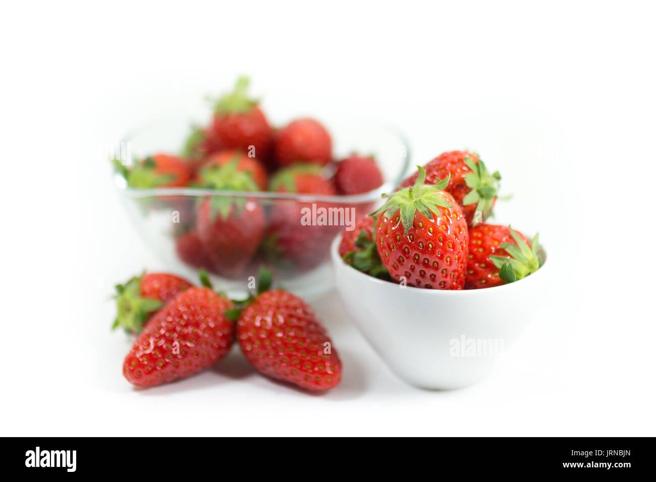 fresh ripe strawberries isolated on white background - Stock Image