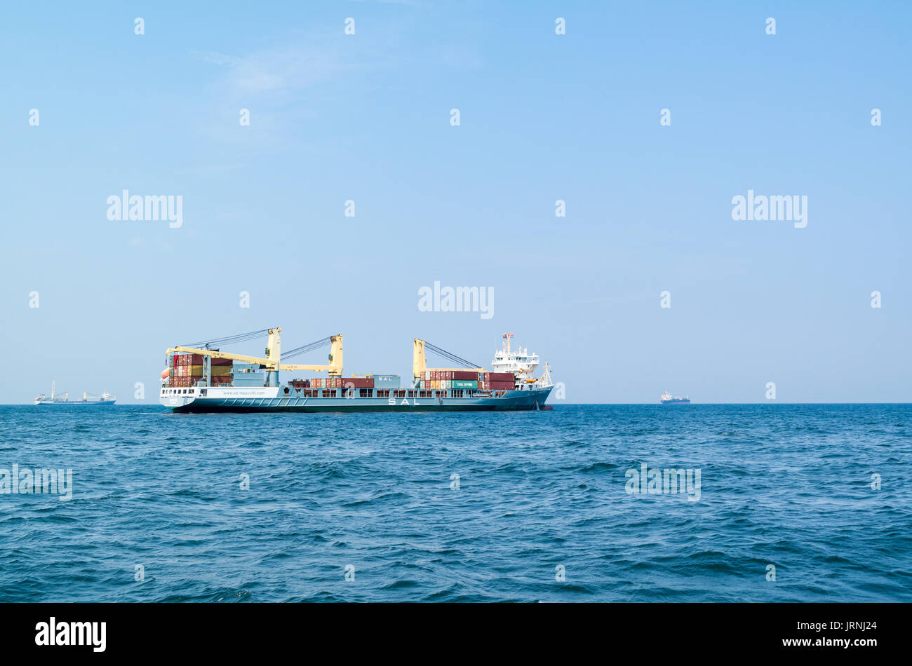 Heavy load carrier SAL Grietje with containers on deck on North Sea near port of Rotterdam, Netherlands - Stock Image