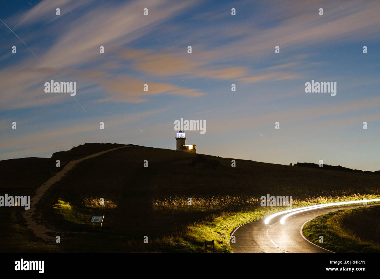 Beachy Head,UK.5th Aug 2017.UK weather. The ISS, or International space station, passes near Belle Tout lighthouse on a fine evening in East Sussex,UK Credit: Ed Brown/Alamy Live News - Stock Image