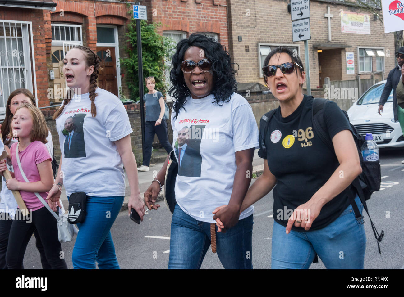 London, UK. 4th Aug, 2017. London, UK. 4th August 2017. Becky Shah of the Hillsborough Justice Campaign and Jermaine Baker's mother march hand in hand from Broadwater Farm to a rally at Tottenham Police Station remembering the death of Mark Duggan on the sixth anniversary of his killing by police, and also the police killing of other members of the Tottenham community - Cynthia Jarrett, Joy Gardner, Roger Sylvester, Mark Duggan and Jermaine Baker and the recent murders of Rashan Charles, Darren Cumberbatch and Edson Da Costa. Led by Stafford Scott, there was poetry, a minute of silence and - Stock Image