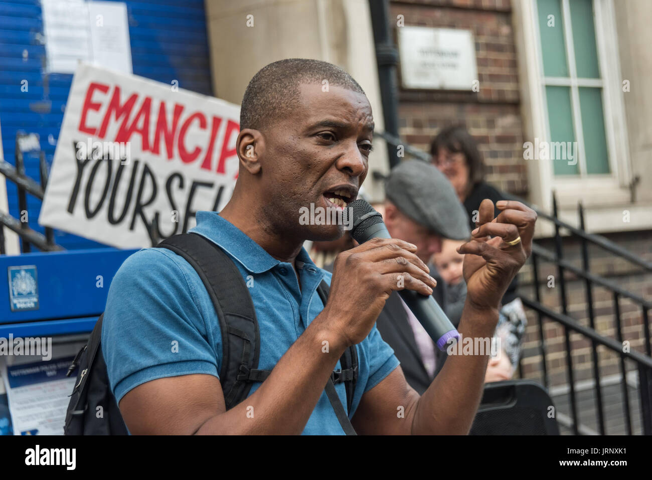 London, UK. 4th Aug, 2017. London, UK. 4th August 2017. Tottenham community activist Stafford Scott speaks at the rally at Tottenham Police Station remembering the death of Mark Duggan on the sixth anniversary of his killing by police, and also the police killing of other members of the Tottenham community - Cynthia Jarrett, Joy Gardner, Roger Sylvester, Mark Duggan and Jermaine Baker and the recent murders of Rashan Charles, Darren Cumberbatch and Edson Da Costa. Led by Stafford Scott, there was poetry, a minute of silence and speeches from family members as well as local activists, Becky - Stock Image