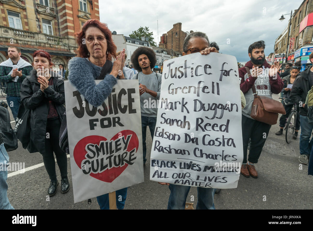 London, UK. 4th Aug, 2017. London, UK. 4th August 2017. People at the rally at Tottenham Police Station remembering the death of Mark Duggan on the sixth anniversary of his killing by police, and also the police killing of other members of the Tottenham community - Cynthia Jarrett, Joy Gardner, Roger Sylvester, Mark Duggan and Jermaine Baker and the recent murders of Rashan Charles, Darren Cumberbatch and Edson Da Costa. Led by Stafford Scott, there was poetry, a minute of silence and speeches from family members as well as local activists, Becky Shah from the Hillsborough campaign and a sp - Stock Image