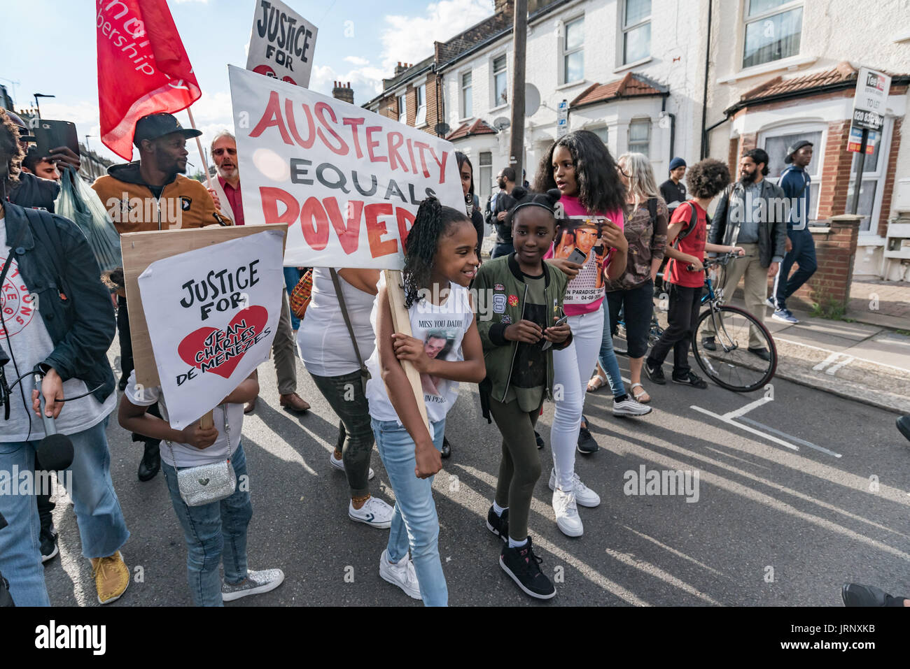 London, UK. 4th Aug, 2017. London, UK. 4th August 2017. People incuding many families and firends of people killed by police march from Broadwater Farm to a rally at Tottenham Police Station remembering the death of Mark Duggan on the sixth anniversary of his killing. The event also remembered the police killing of other members of the Tottenham community - Cynthia Jarrett, Joy Gardner, Roger Sylvester, Mark Duggan and Jermaine Baker and the recent murders of Rashan Charles, Darren Cumberbatch and Edson Da Costa. Led by Stafford Scott, there was poetry, a minute of silence and speeches from - Stock Image