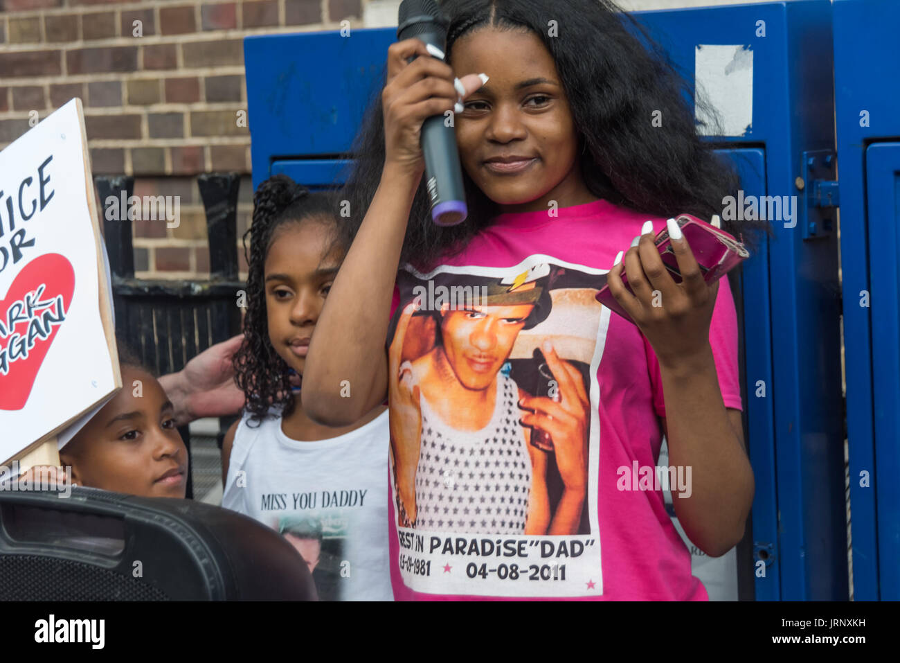 London, UK. 4th Aug, 2017. London, UK. 4th August 2017. Mark Duggan's daughter speaks at the rally at Tottenham Police Station remembering her father on the sixth anniversary of his killing by police, and also the police killing of other members of the Tottenham community - Cynthia Jarrett, Joy Gardner, Roger Sylvester, Mark Duggan and Jermaine Baker and the recent murders of Rashan Charles, Darren Cumberbatch and Edson Da Costa. Led by Stafford Scott, there was poetry, a minute of silence and speeches from family members as well as local activists, Becky Shah from the Hillsborough campaign - Stock Image