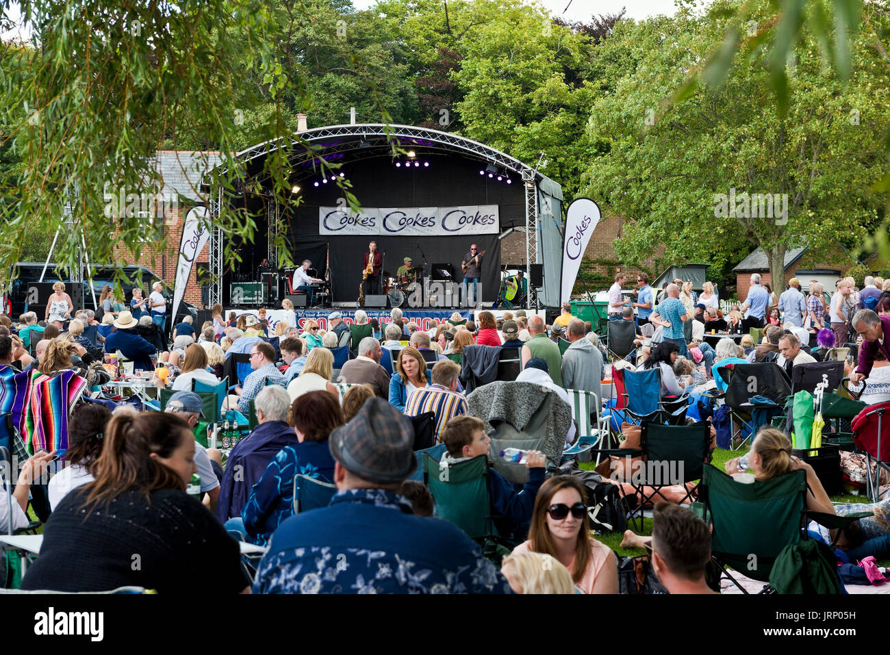 Christchurch, UK. 05th Aug, 2017. Large crowds attend the 23rd annual free jazz festival. The Snake Davis Band entertain crowds during the afternoon. Credit: Roger Allen Photography/Alamy Live News - Stock Image