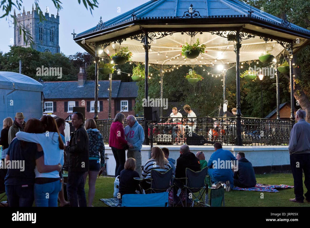 Christchurch, UK. 05th Aug, 2017. Large crowds attend the 23rd annual free jazz festival. The Daryl Ford Organ Trio perform in the band stand at sunset. Credit: Roger Allen Photography/Alamy Live News - Stock Image