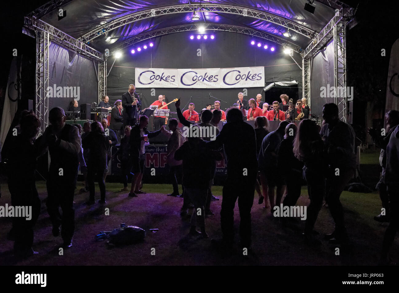 Christchurch, UK. 05th Aug, 2017. Large crowds attend the 23rd annual free jazz festival. The Taverners Big Band end the day with swing music getting the audience dancing. Credit: Roger Allen Photography/Alamy Live News - Stock Image