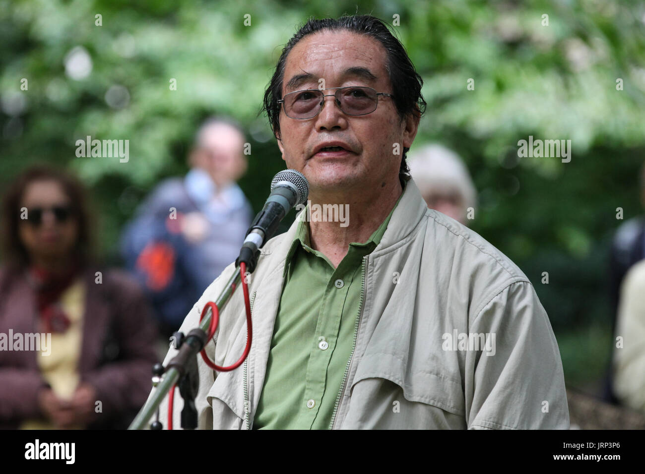 London, UK. 6th August, 2017. Shigeo Kobayashi of the Campaign for Nuclear Disarmament (CND) addresses peace campaigners attending the annual Hiroshima Day anniversary event in Tavistock Square, next to the commemorative Hiroshima cherry tree. Credit: Mark Kerrison/Alamy Live News - Stock Image