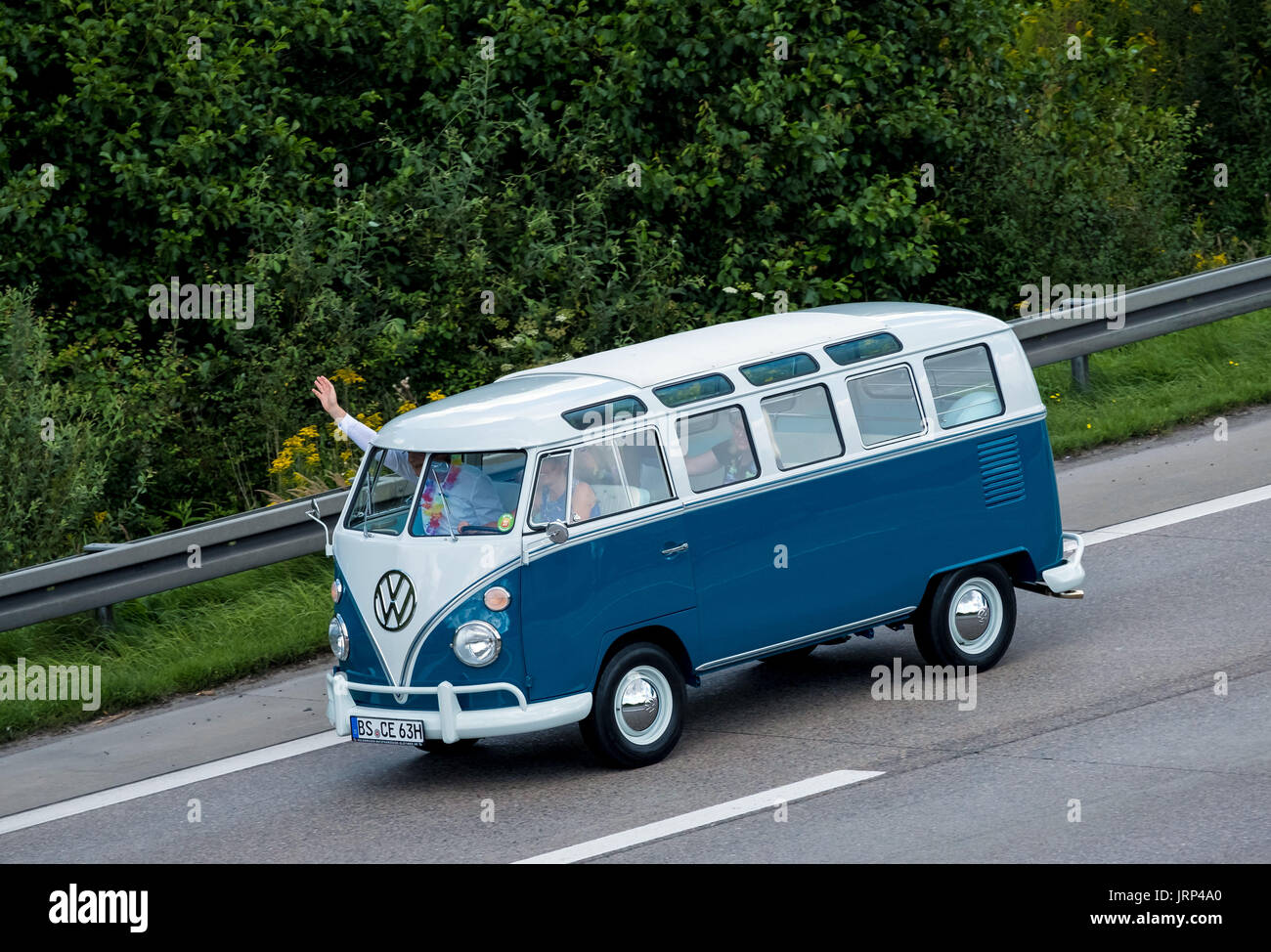 Stocken, Germany. 06th Aug, 2017. An old VW Kombi driving to the Volkswagen Commercial Vehicles Plant for the Kombi Meet on the occasion of the 70th anniversary of the Volkswagen Transporter in Stocken, Germany, 06 August 2017. Photo: Peter Steffen/dpa/Alamy Live News - Stock Image