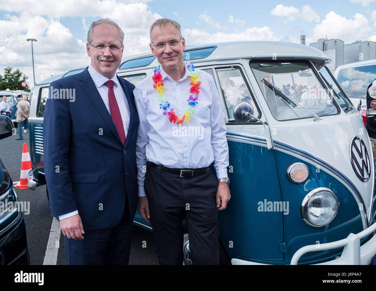 Stocken, Germany. 06th Aug, 2017. Hannover Mayor Stefan Schostok (L) and the Chairman of Brand Management of Volkswagen Commercial Vehicles, Eckhard Scholz, pictured in the grounds of the Volkswagen Commercial Vehicles Plant during the Kombi Meet on the occasion of the 70th anniversary of the Volkswagen Transporter in Stocken, Germany, 06 August 2017. Photo: Peter Steffen/dpa/Alamy Live News - Stock Image