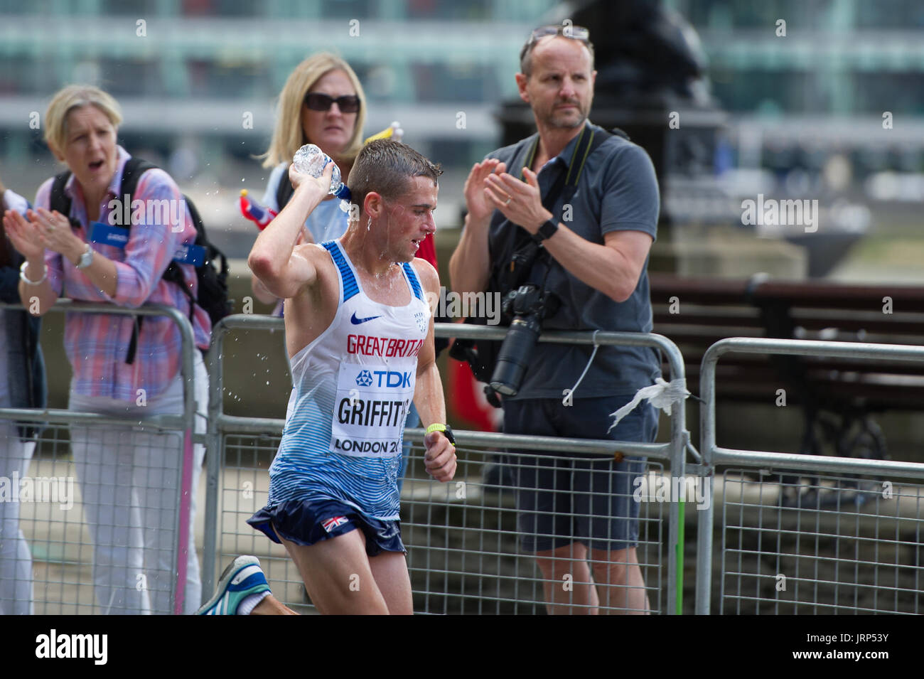 London, UK. 6th August, 2017. Josh Griffiths (Great Britain) taking water refreshment at the IAAF World Athletics Championships Men's Marathon Race Credit: Phil Swallow Photography/Alamy Live News - Stock Image