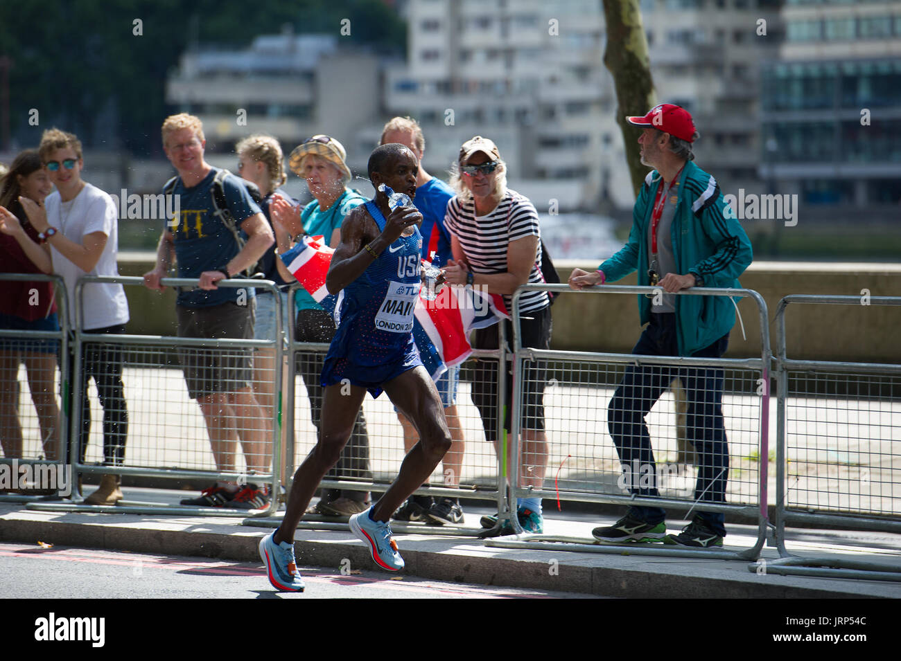 London, UK. 6th August, 2017. Augustus Mayo (USA) taking a water refreshment at the IAAF World Athletics Championships Men's Marathon Race Credit: Phil Swallow Photography/Alamy Live News - Stock Image