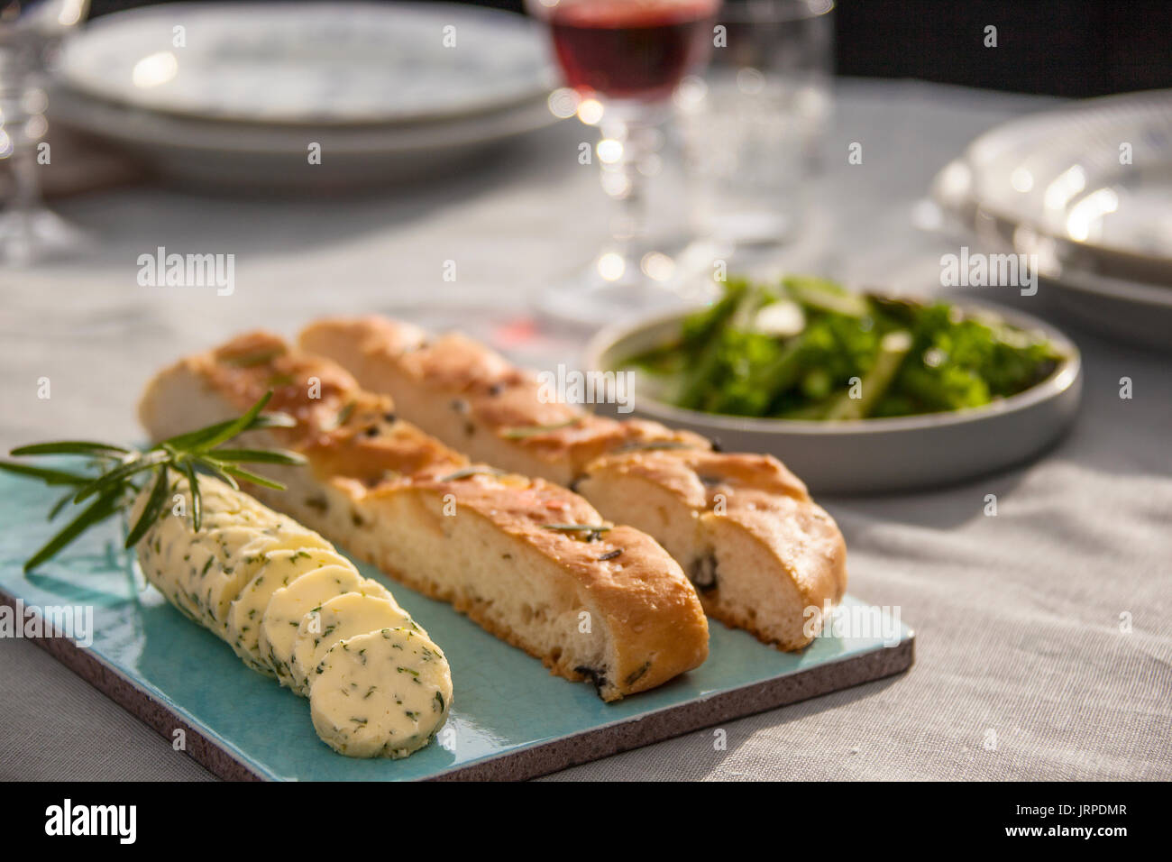 Closeup of Focaccia bread and herbed butter - Stock Image