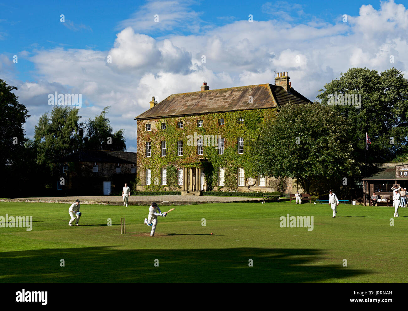 Cricket match in the village of Crakehall, North Yorkshire, England UK - Stock Image