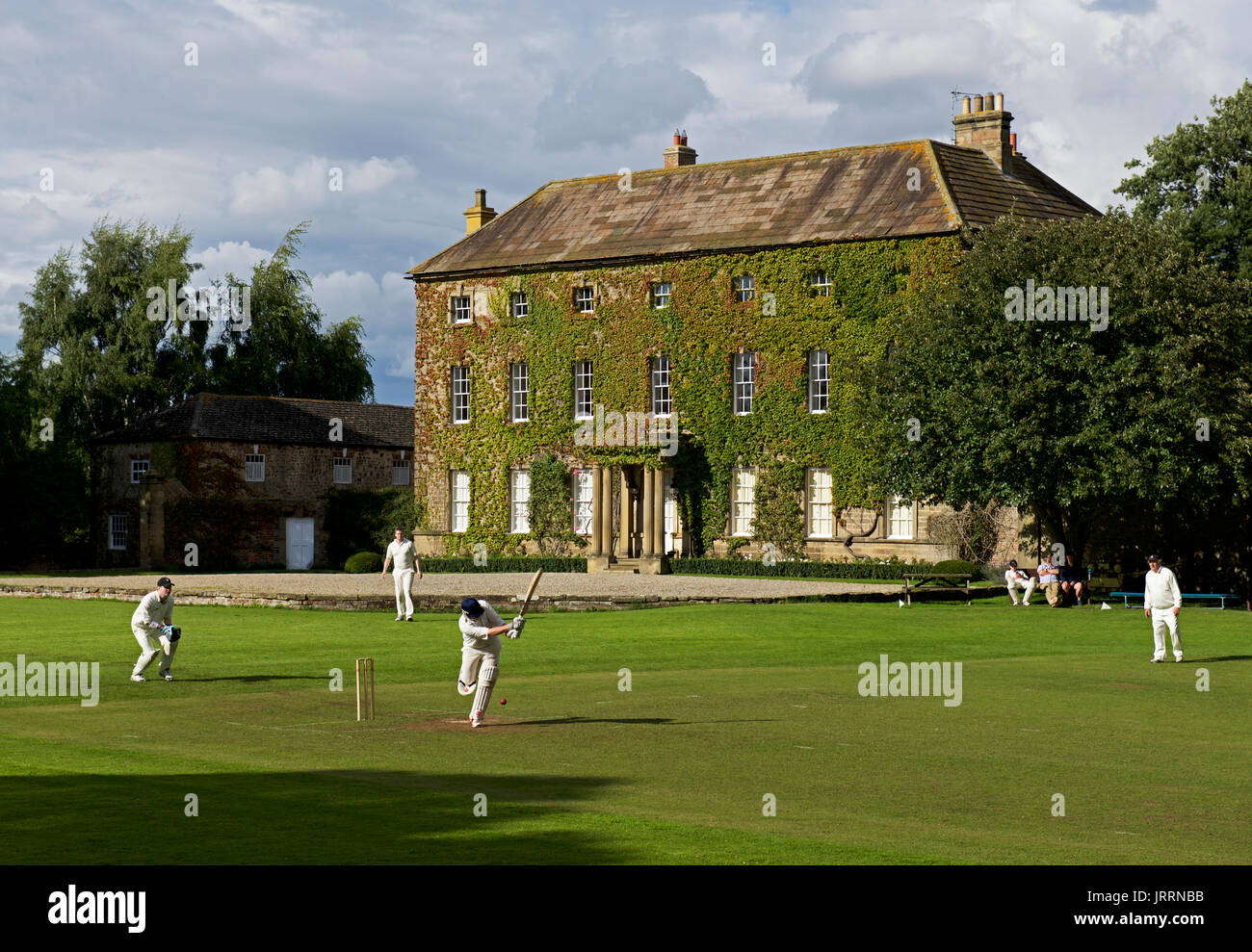 Cricket match in the village of Crakehall, North Yorkshire, England UK Stock Photo