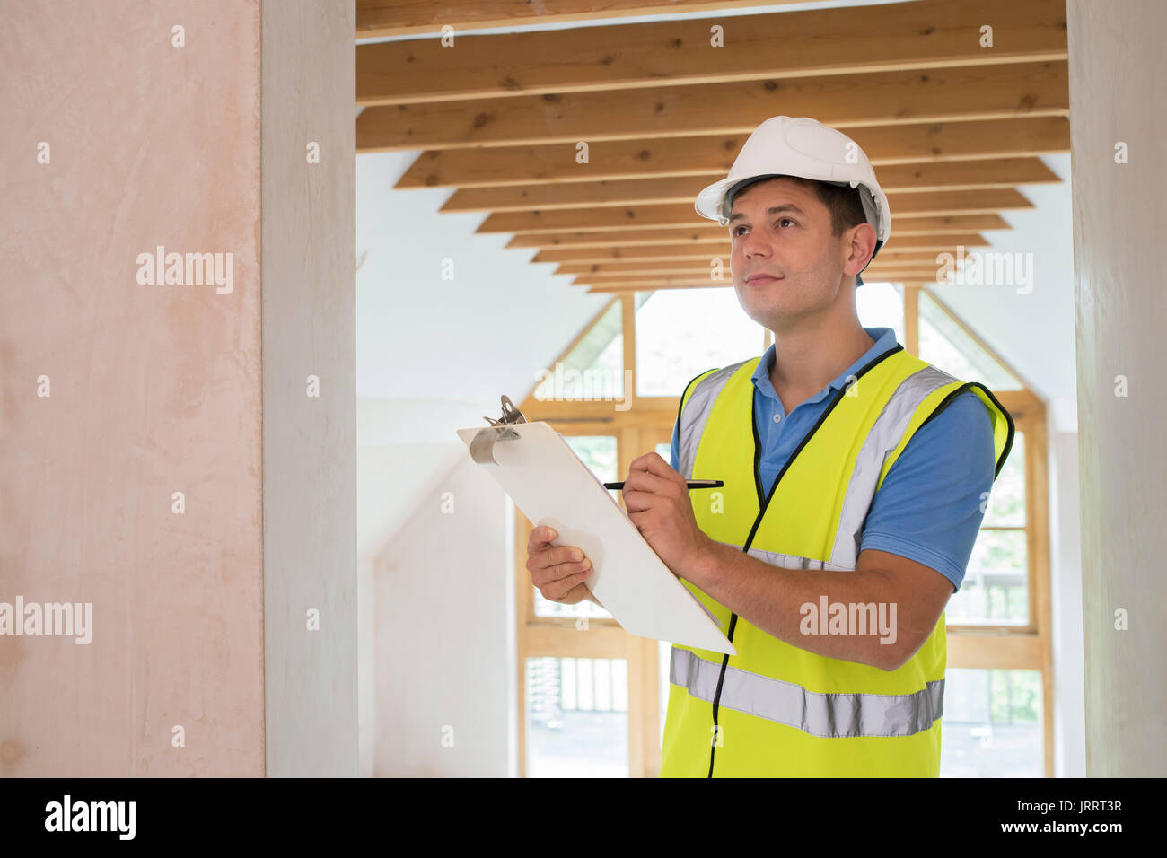 Building Inspector Looking At New Property - Stock Image