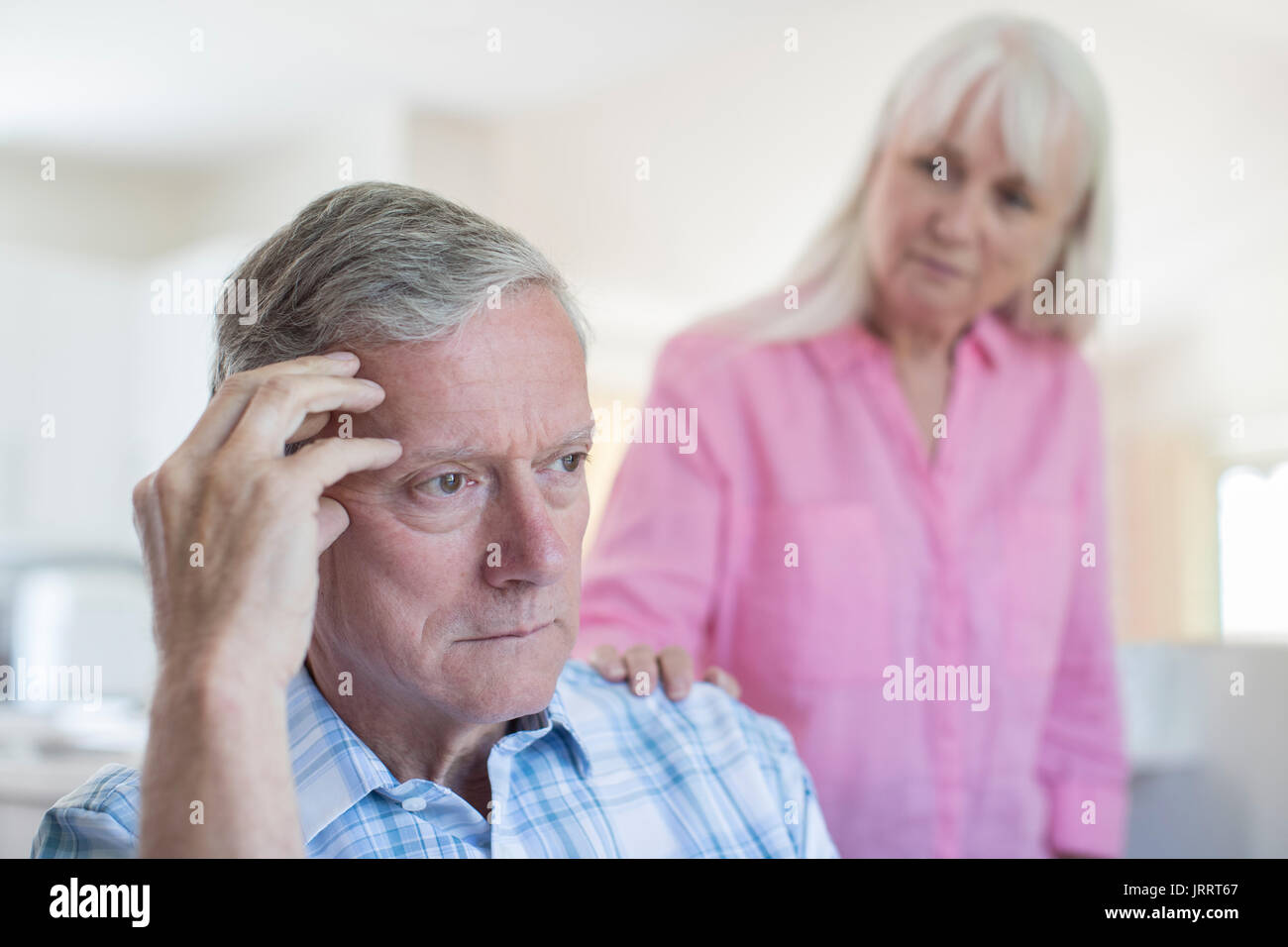 Mature Woman Comforting Man With Depression At Home - Stock Image