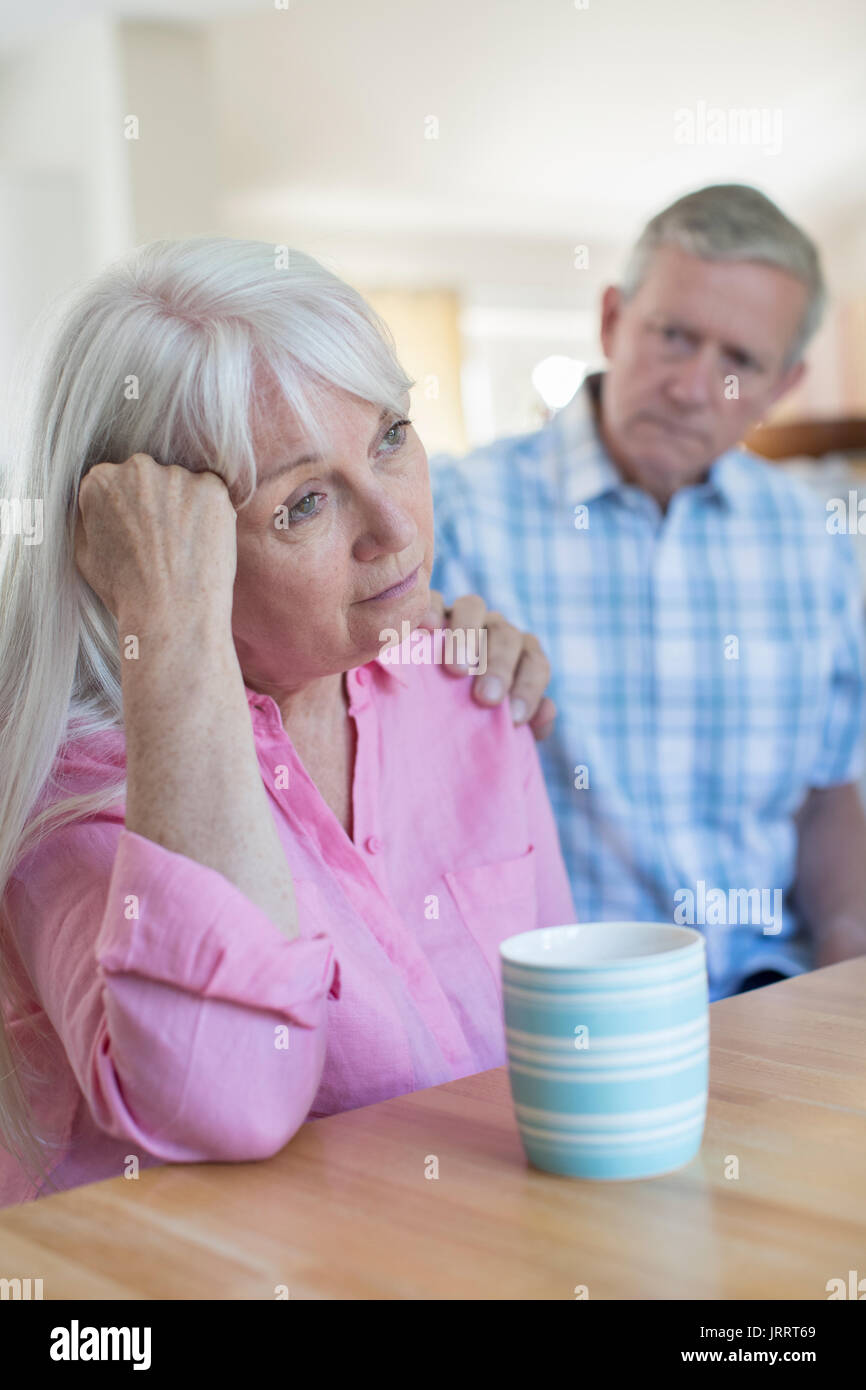 Mature Man Comforting Woman With Depression At Home - Stock Image