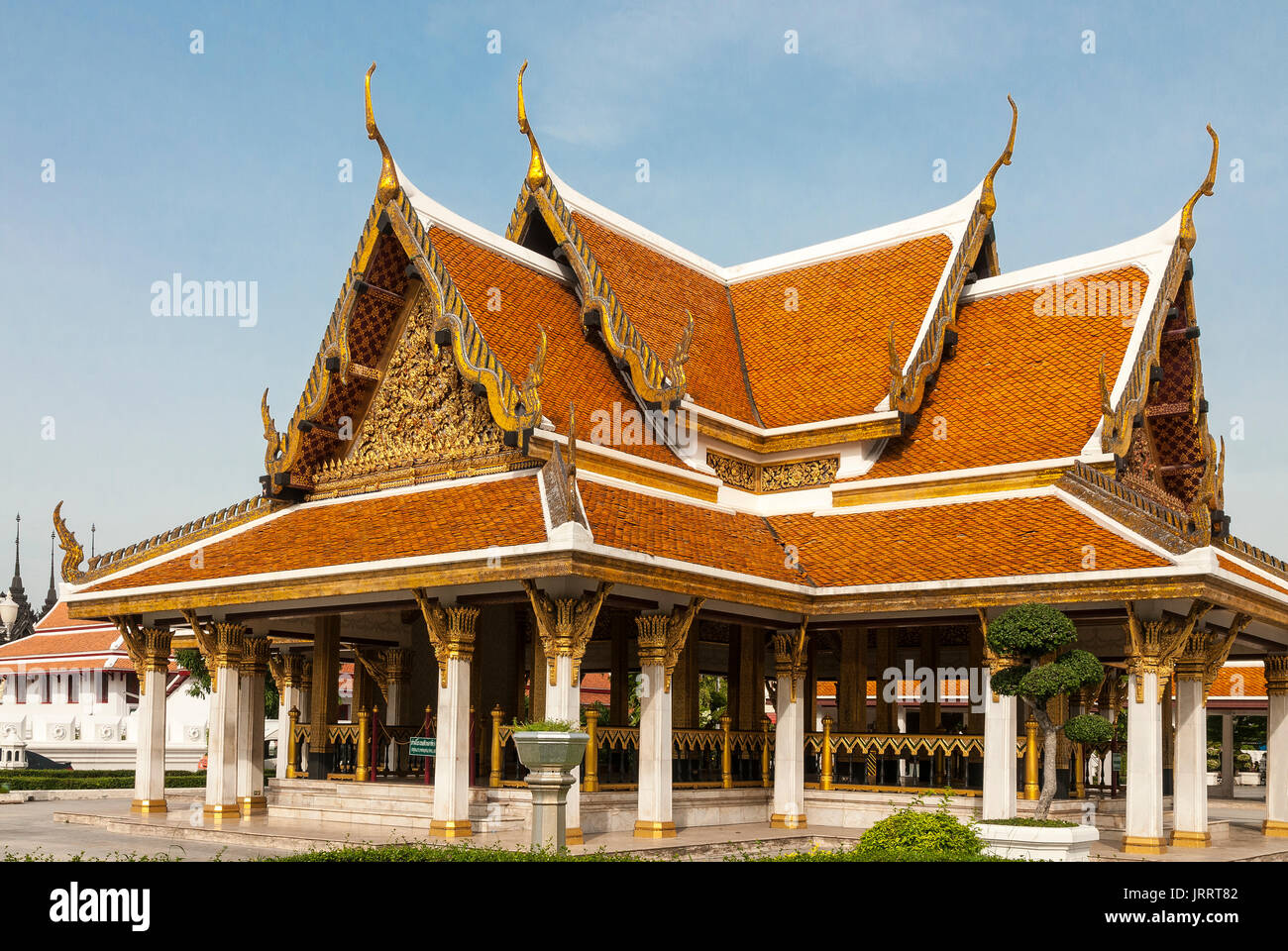 Traditional carved and guilded roof to a Royal reception, pavillion at the Rattanakosin Exhibition Hall, Bangkok, Thailand - Stock Image
