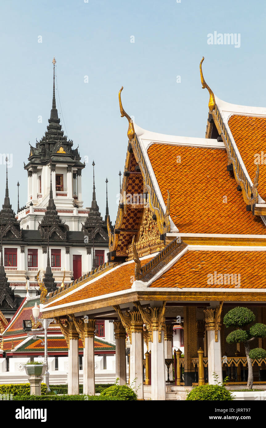 Traditional carved and guilded, gables and eaves to a roof on a Royal reception, pavillion at the Rattanakosin Exhibition Hall, Bangkok, Thailand - Stock Image