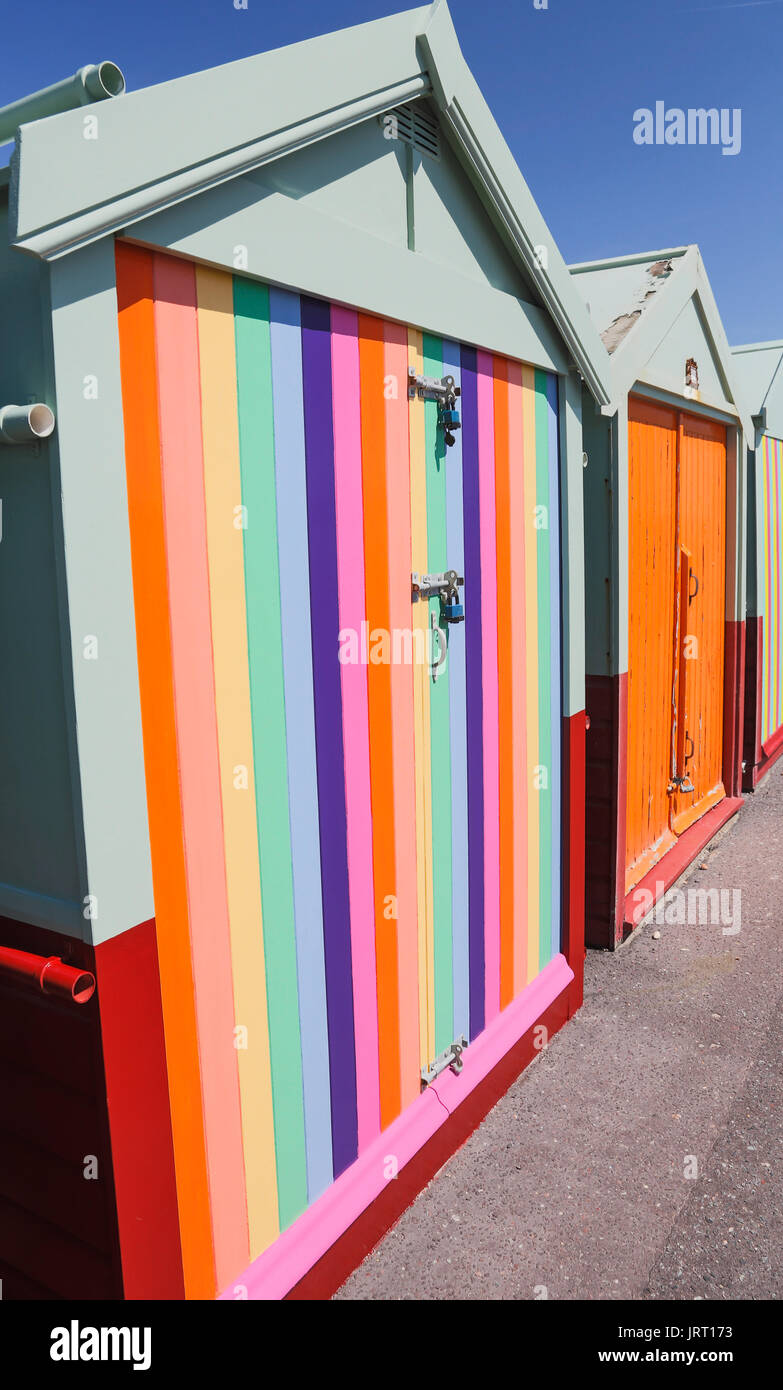 Rainbow painted beach huts on Pride weekend, Hove - Stock Image