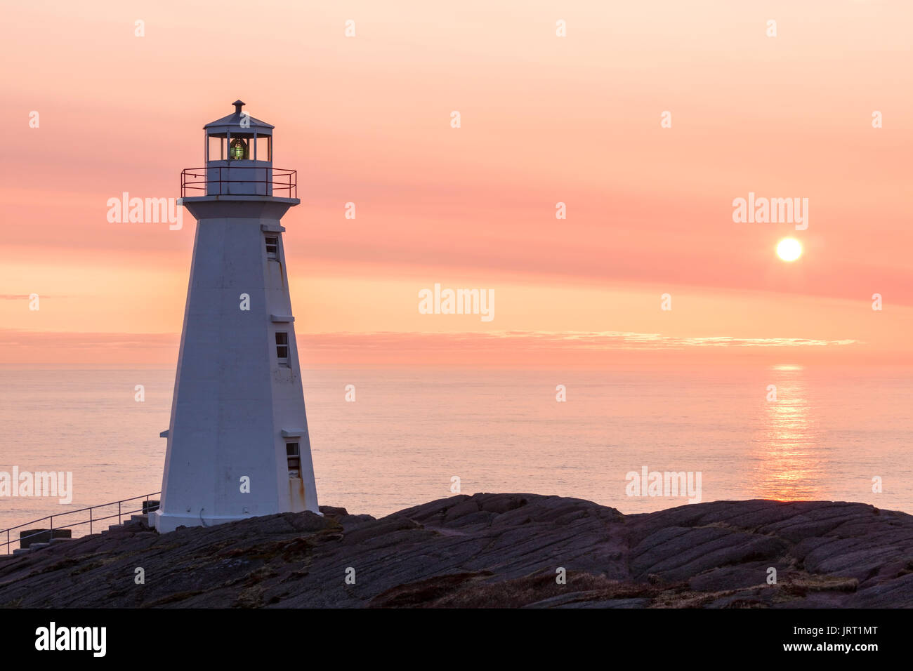 The 1955 concrete Lighthouse at Cape Spear National Historic Site of Canada at sunrise. Cape Spear, St. John's, Newfoundland and Labrador, Canada. - Stock Image