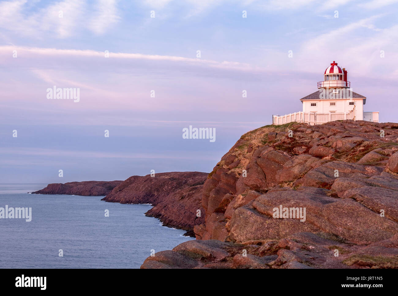 The 1836 Lighthouse at Cape Spear National Historic Site of Canada at sunrise. Cape Spear, St. John's, Newfoundland and Labrador, Canada. - Stock Image