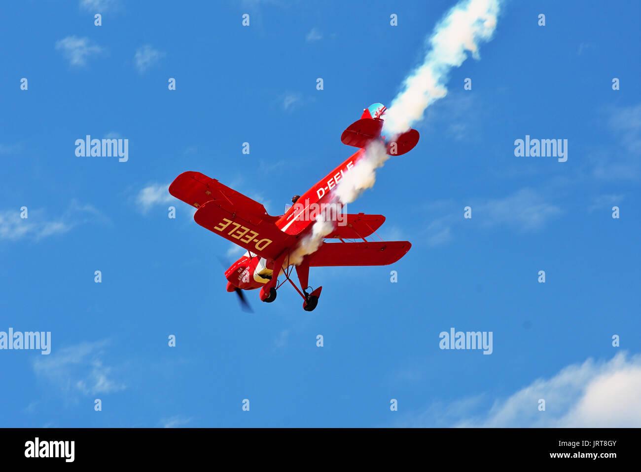Memorial Airshow, 24th of June 2017, Roudnice, Czech Republic. Bucker Jungmeister in flight, smoke effect - Stock Image