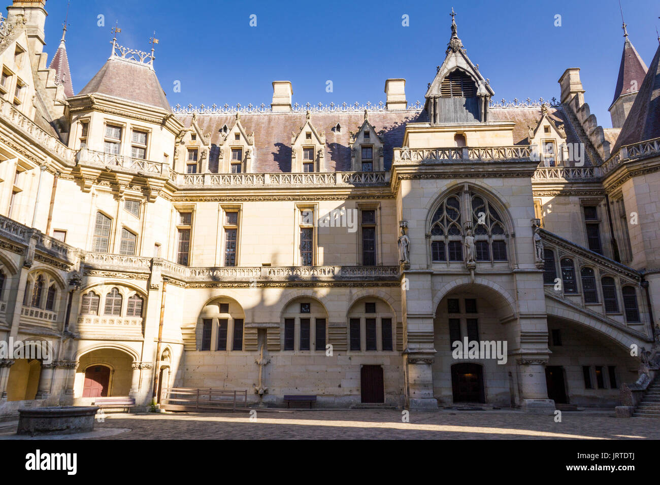 Medieval castle of Pierrefonds, Picardy, France. Interior courtyard, ornate Gothic facade. Stock Photo