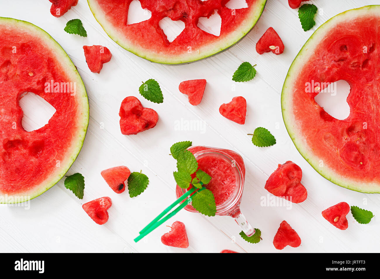 Fresh watermelon smoothies with mint on white wooden background. Flat lay. Top view - Stock Image