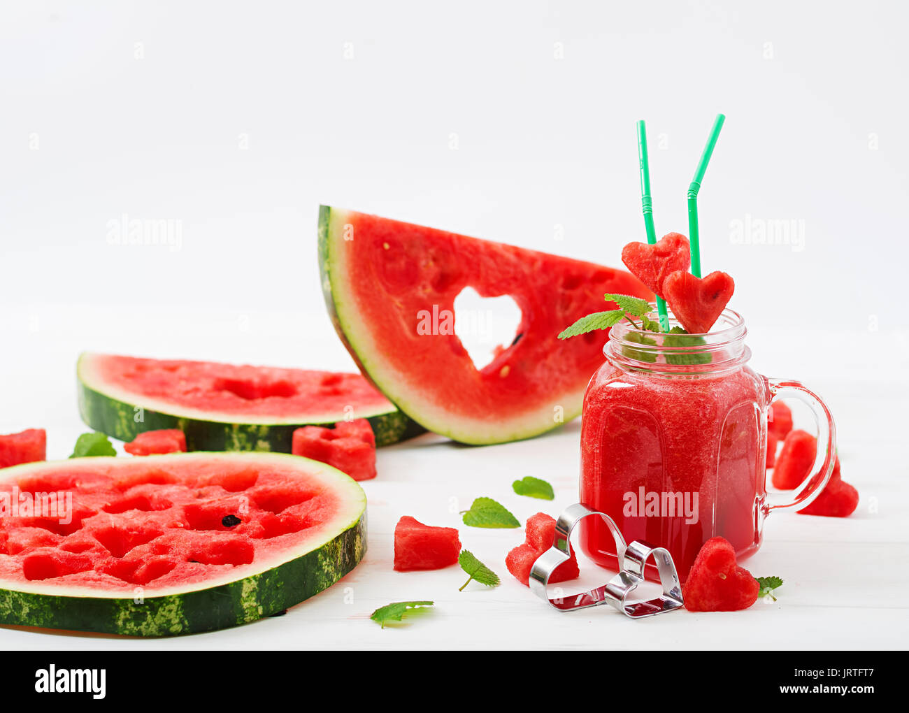 Fresh watermelon smoothies with mint on white wooden background. - Stock Image