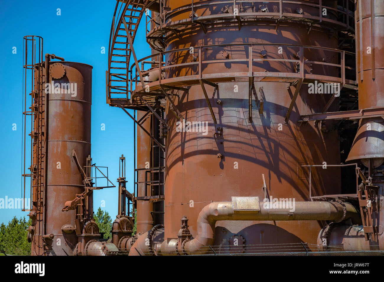 Abandoned old machines and storage units in a gas industry at gas works park Seattle. Machineries and storage units in a gas industry at gas works par & Abandoned old machines and storage units in a gas industry at gas ...
