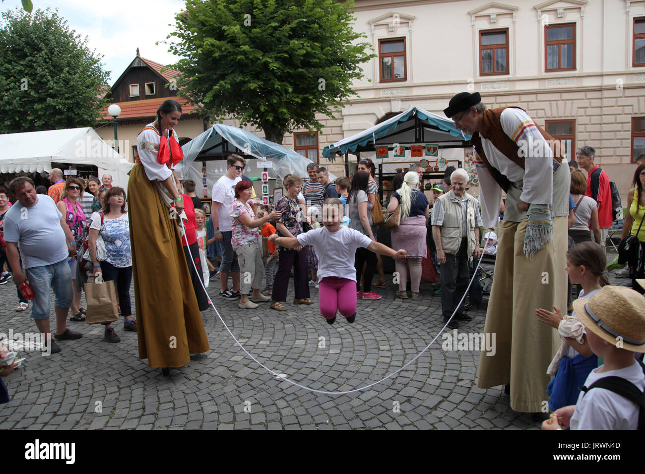 Actors entertain a crowd at The European Folk and Crafts Festival, Kezmarok, Slovakia. - Stock Image