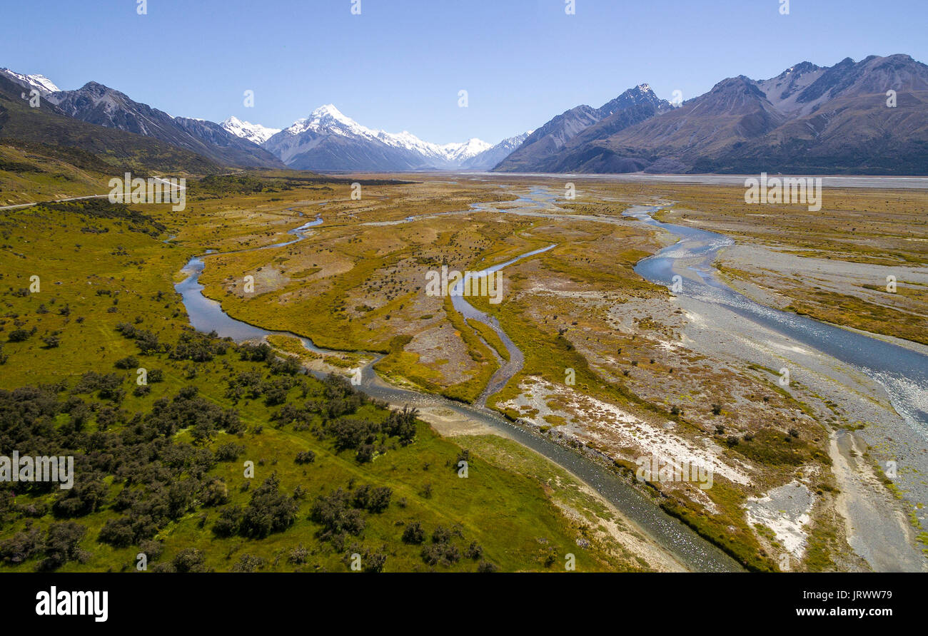 Wide riverbed of Tasman River, Mount Cook at back, Mount Cook National Park, Canterbury Region, South Island, New Zealand - Stock Image