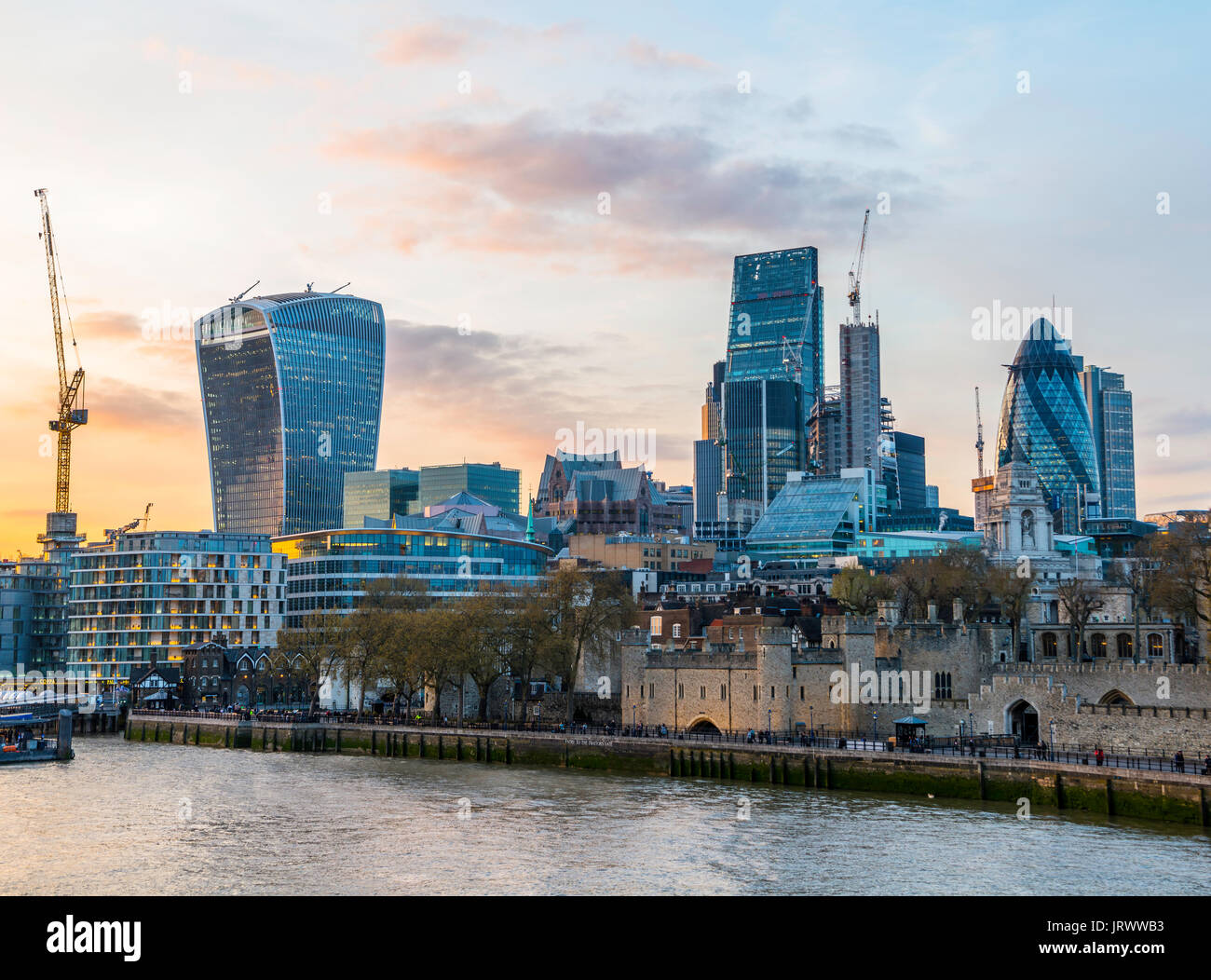 Thames, Tower of London, skyline of the City of London, with the buildings Gherkin, Leadenhall Building and Walkie - Stock Image