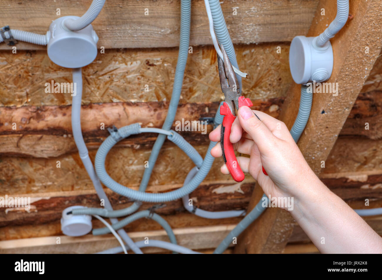 Tremendous An Electrician Hand With Pliers During Installation Mount Light Wiring 101 Mentrastrewellnesstrialsorg