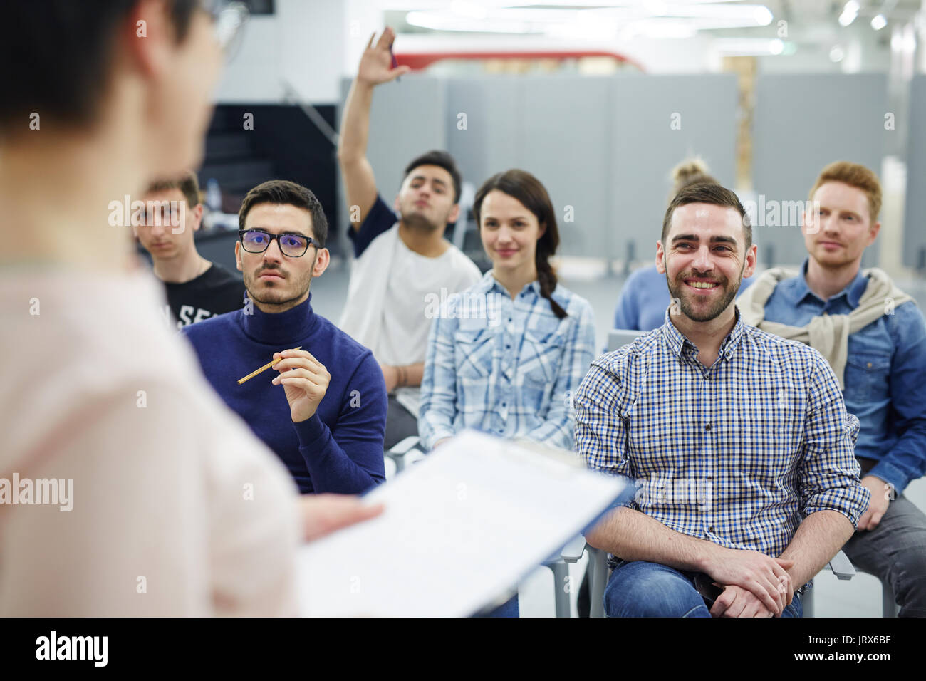 Listening to report of speaker - Stock Image