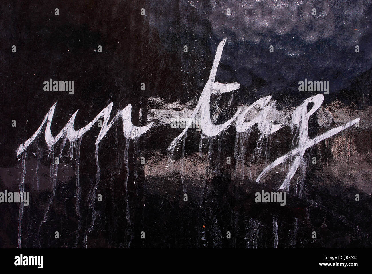 A Tag reading 'A tag' on a wall of Saint-Claude, Franche-Comté, Jura (France) - Stock Image