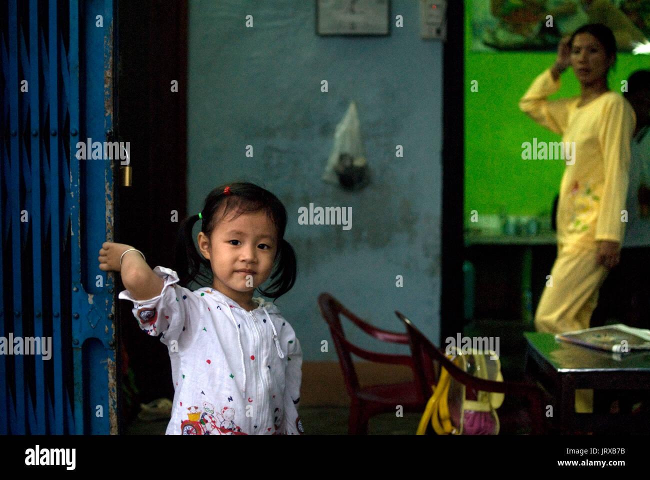 Coy smiling young girl inside a restaurant, Hue, Vietnam, Southeast Asia - Stock Image