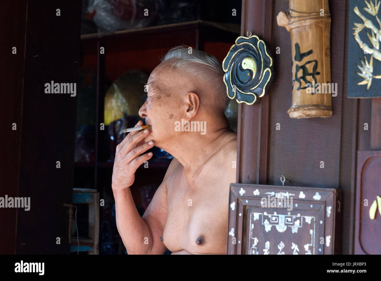 Man Smoke A Cigaret Naket Outside The House Hoi An Vietnam Stock