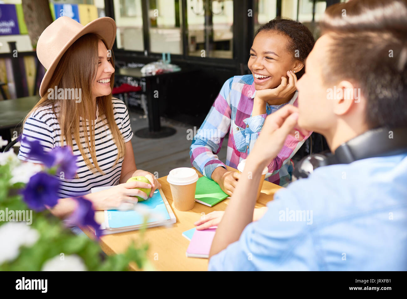 Young People Studying in Cafe - Stock Image